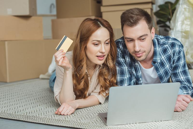 couple buying goods online together at new home, moving royalty free stock images