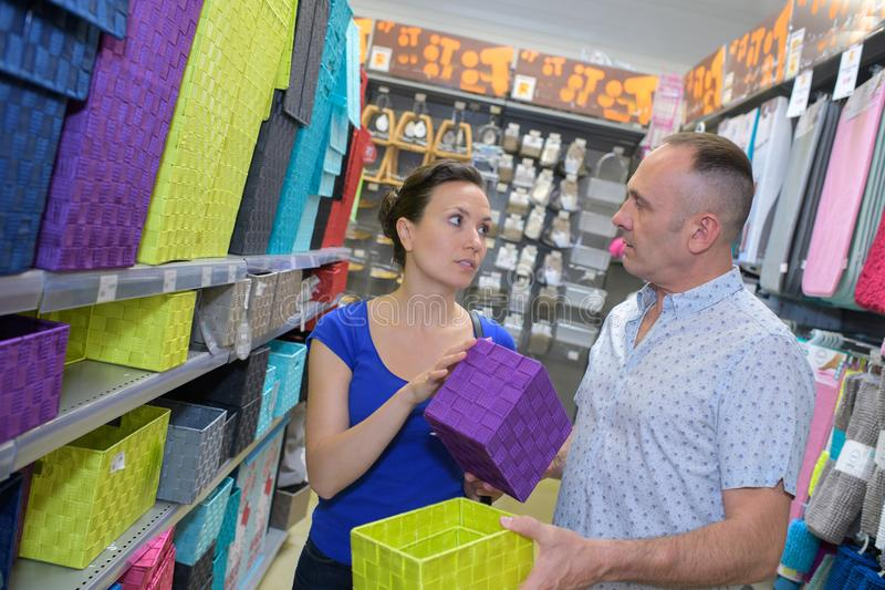 Couple buying house ware in shop. Couple buying house ware in the shop stock image