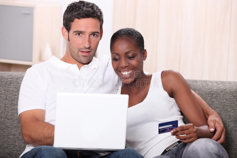 Couple buying on-line stock photo