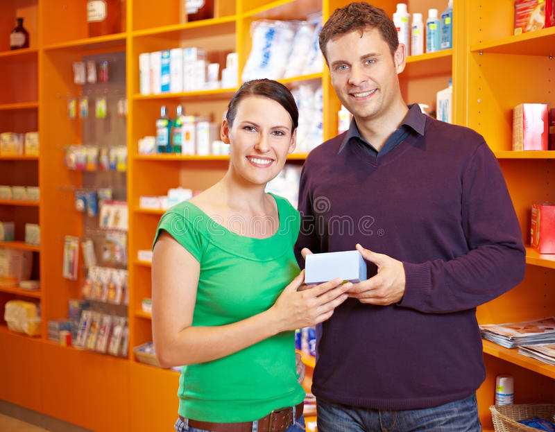 Download Couple Buying Medicine In Pharmacy Stock Photo - Image: 21711340