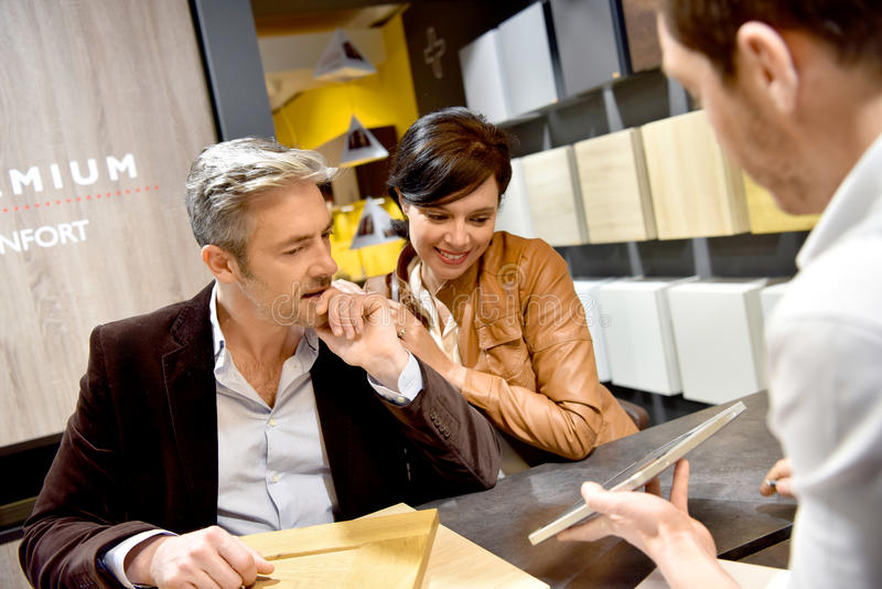 Couple buying new kitchen furniture royalty free stock photo