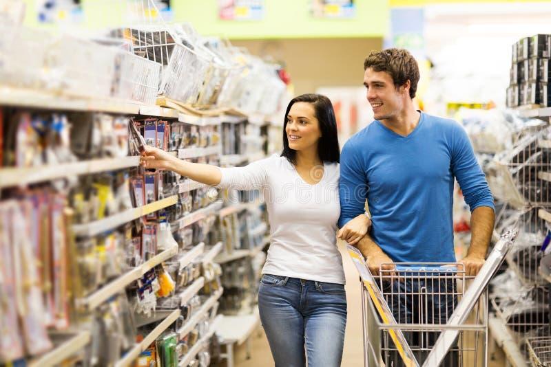 Couple buying padlock stock image