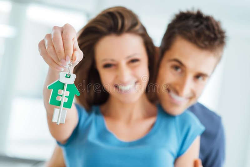 Couple buying their new house stock photography