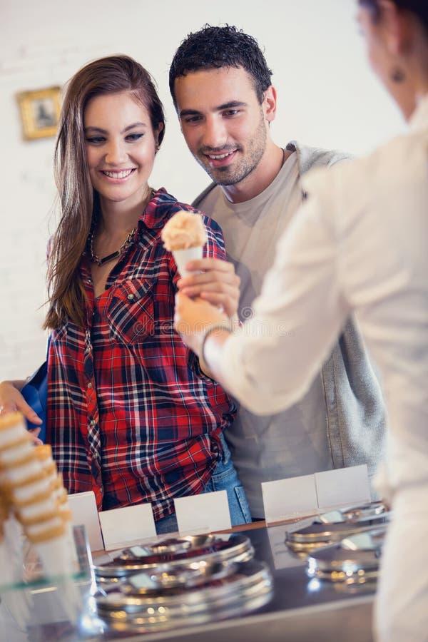 Couple buys ice cream stock photo