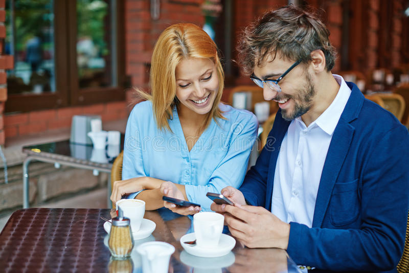 Couple at cafe stock photography