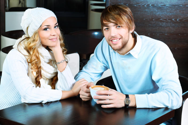 Couple at caffee royalty free stock photography