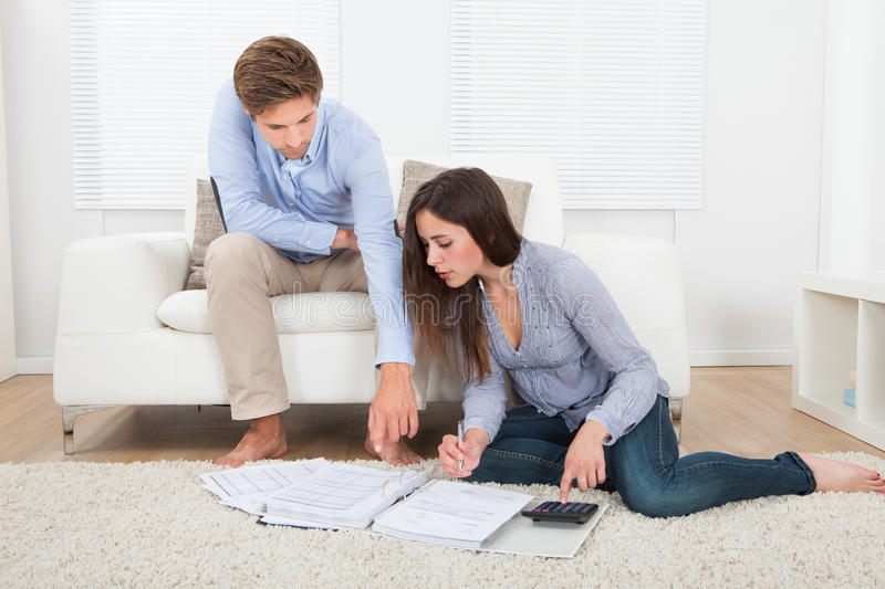 Couple calculating budget at home stock image
