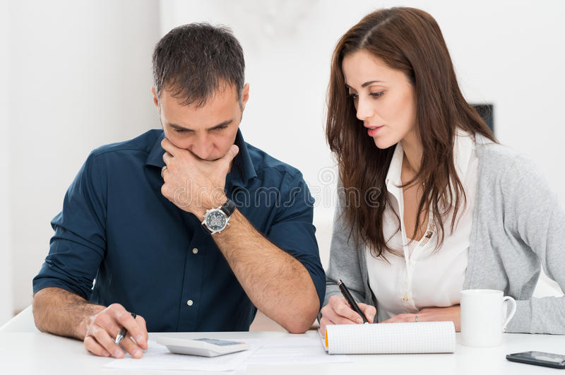 Couple Calculating Budget stock image
