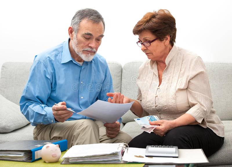 Couple calculating home finances. Senior couple worrying about their money situation royalty free stock photography