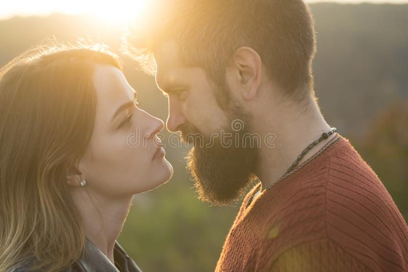 Couple with calm faces stand close, looks with tenderness. royalty free stock photos
