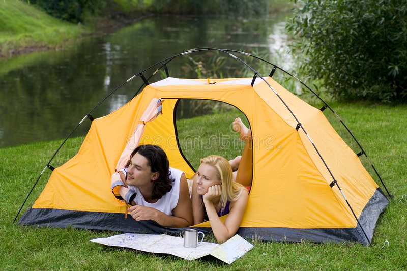 Couple camping stock photography