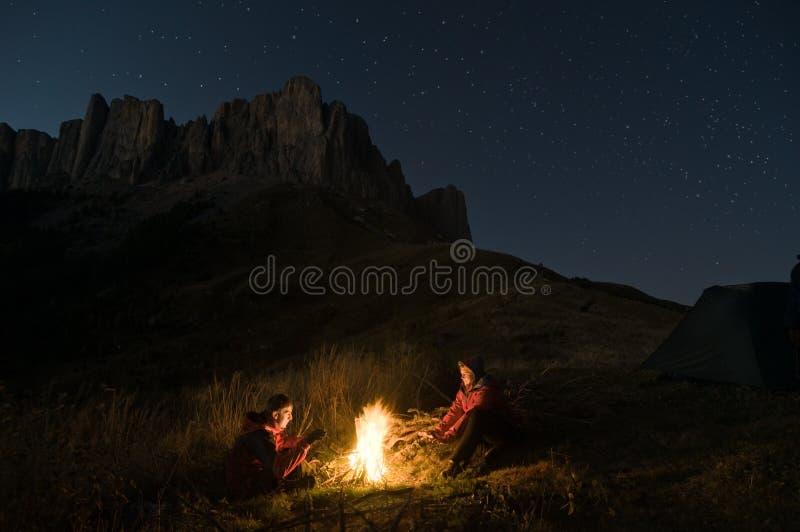 Couple camping at night royalty free stock photos