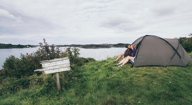 Couple camping with a tent at the seaside in Bergen, Norway stock photos