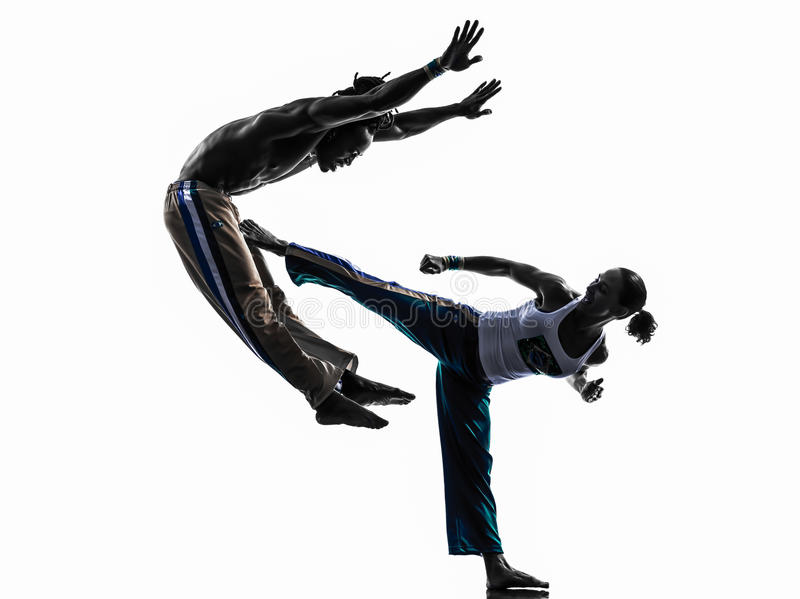 Couple capoeira dancers dancing silhouette royalty free stock images