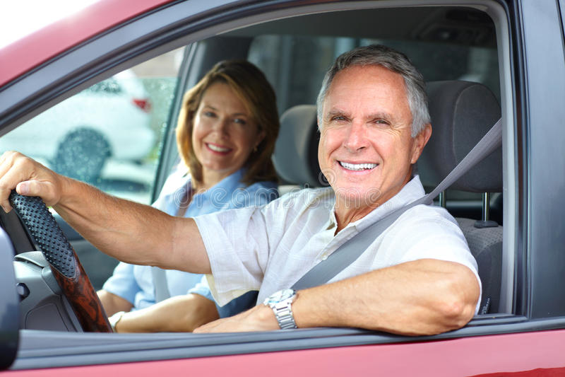 Couple in the car. Smiling happy elderly couple in the car