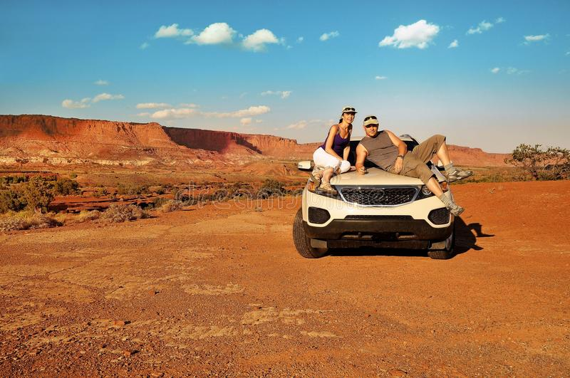 Couple on car during road trip USA royalty free stock photos