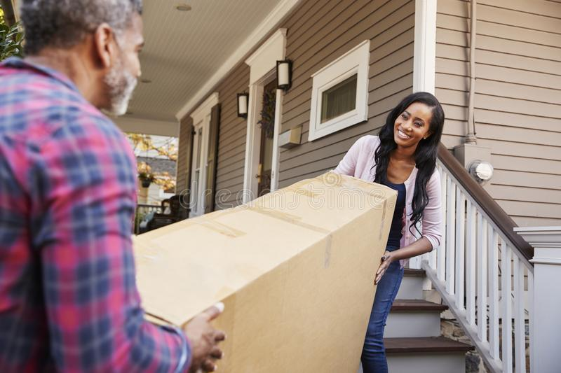 Couple Carrying Big Box Purchase Into House stock image