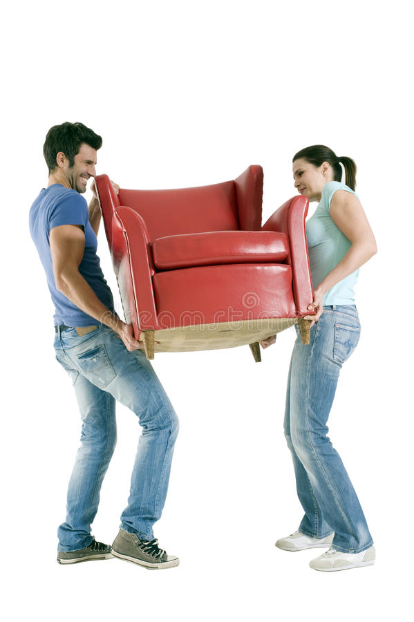 Couple carrying a chair stock photography