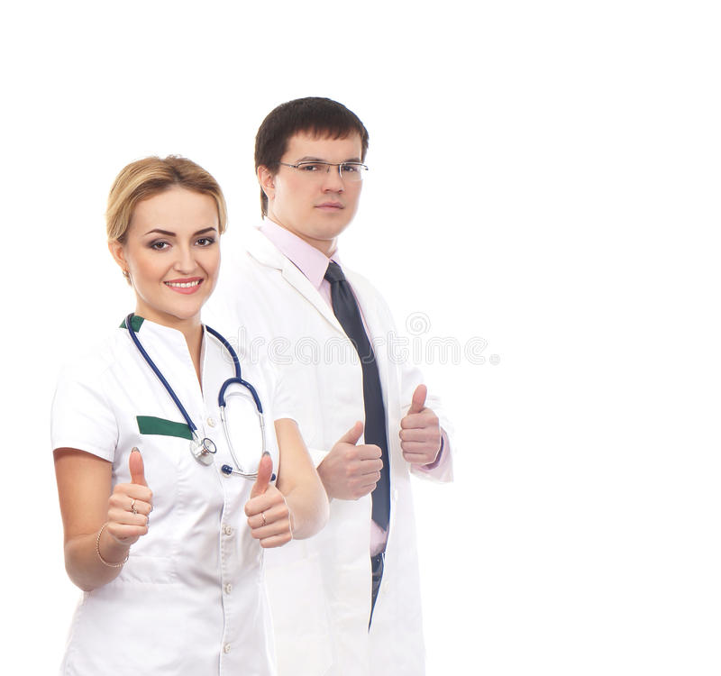 Download A Couple Of Caucasian Doctors Holding Thumbs Up Stock Photo - Image: 26536850