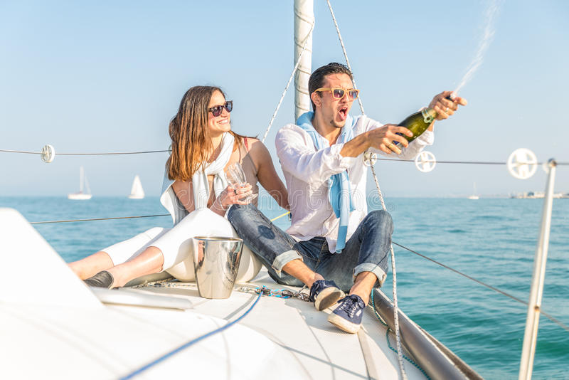 Couple celebrating on the boat stock photos