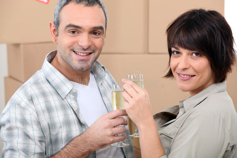 Couple Celebrating On Moving Day Royalty Free Stock Images