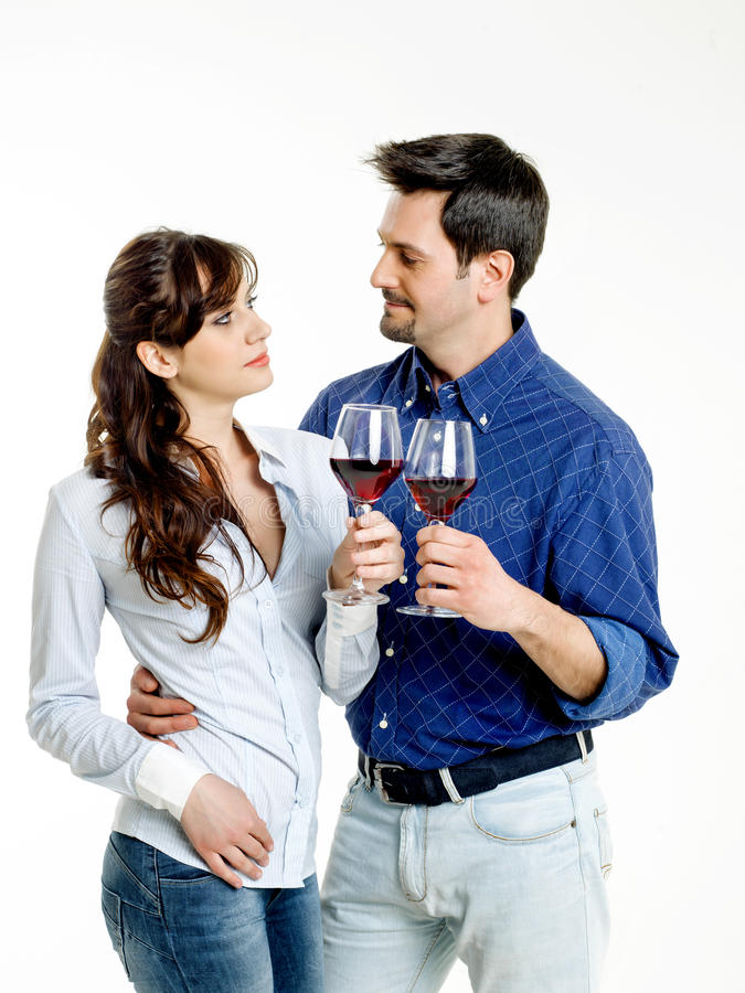 Couple celebrating with red wine. Young couple celebrating with red wine stock photo