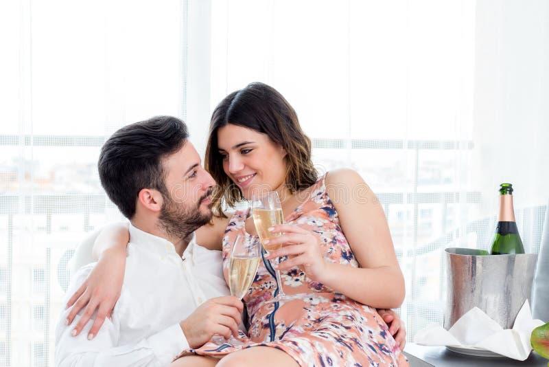 Couple celebrating weekend getaway in hotel. stock photo