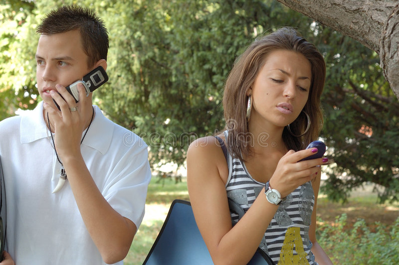 Download Couple with cell phones stock photo. Image of teenager - 6627864