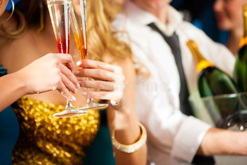 Couple with Champagner in club or party. Young couple with Champagner in club or party having fun, close-up royalty free stock photography