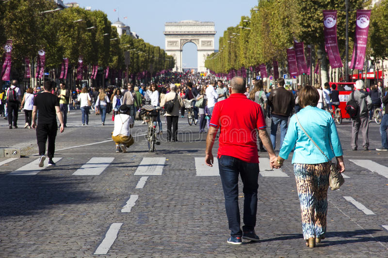 Couple on Champs Elysees at Paris car free day stock photos