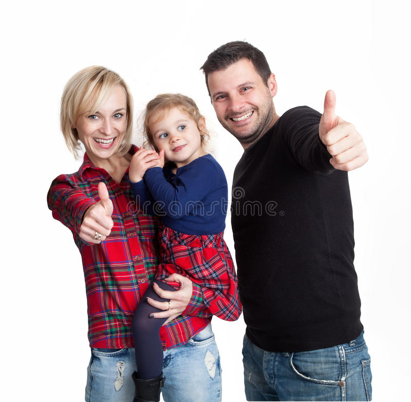 Couple with child holding up thumbs stock images