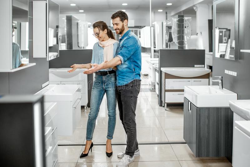 Couple chooosing new bathroom furniture in the shop royalty free stock photo
