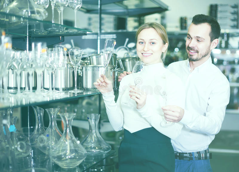Couple chooses glasses for wine stock photography
