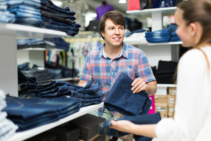 Couple chooses jeans at the shop royalty free stock photos