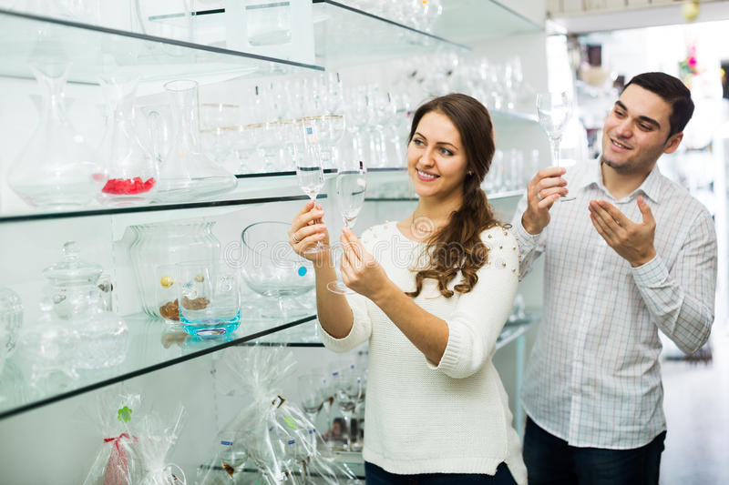Couple chooses the wine glasses stock photography