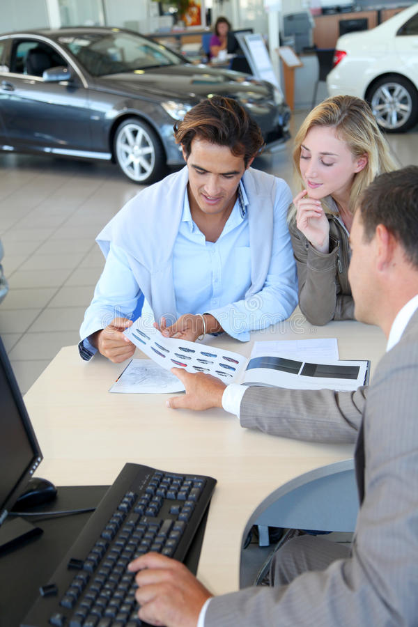 Download Couple choosing car color stock photo. Image of vehicle - 21187590
