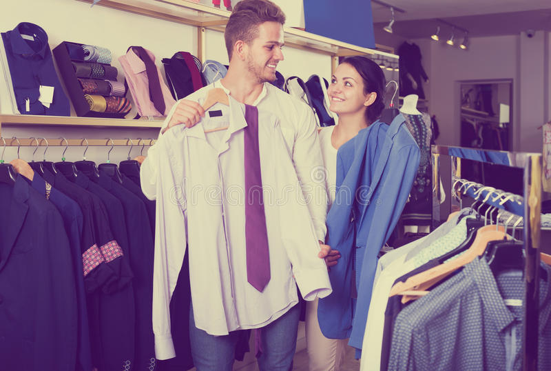 Download Couple Choosing Clothing At Shop Stock Photo - Image: 83702490