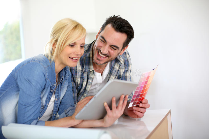 Couple choosing colors for new house stock image
