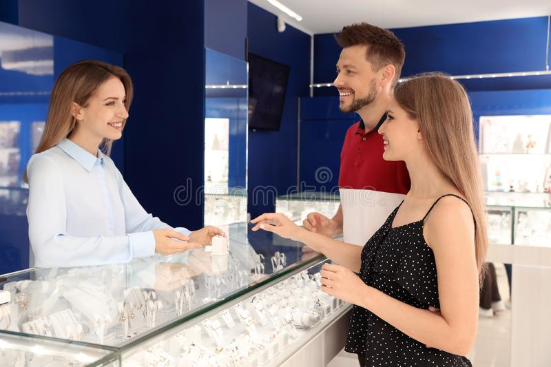 Couple choosing engagement ring stock images