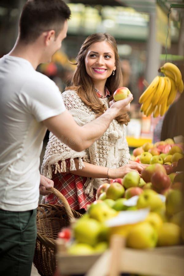 Couple choosing fruit royalty free stock photo