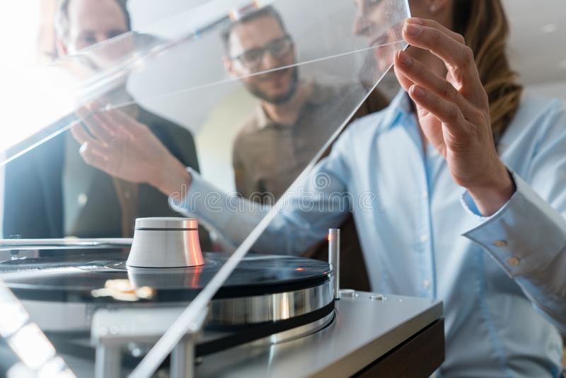Couple choosing turntable record player in a store stock images