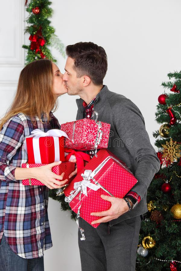Couple with Christmas gifts stock photography
