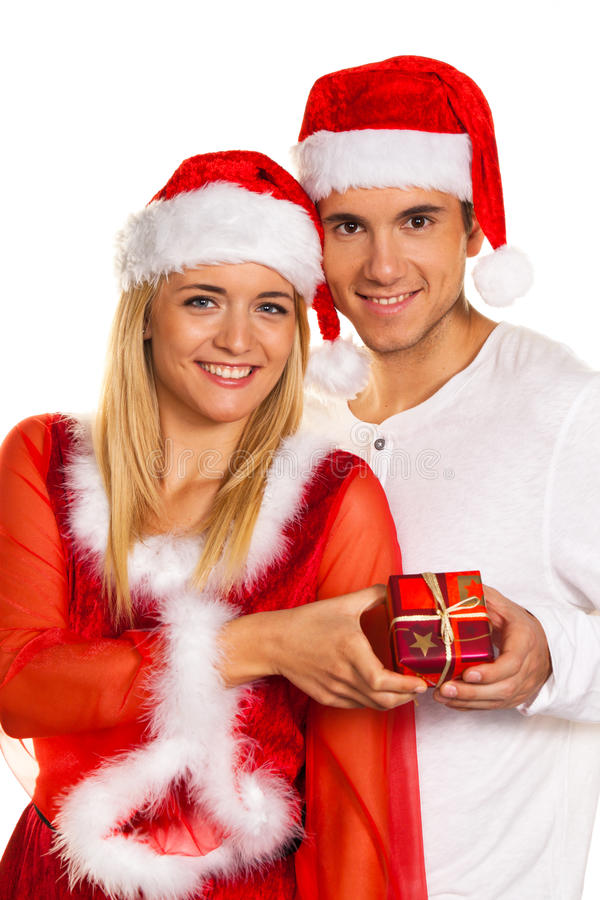 Download Couple At Christmas With Santa Claus Hats Stock Photo - Image: 16250364