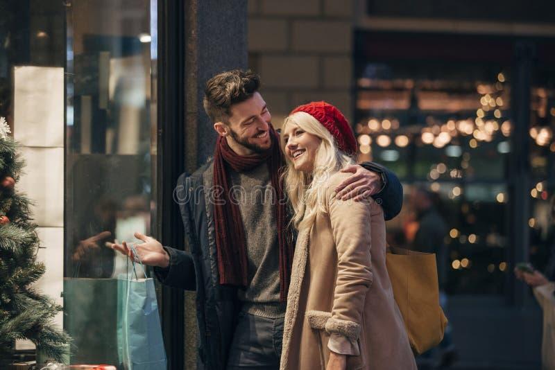 Couple Christmas Shopping royalty free stock photography