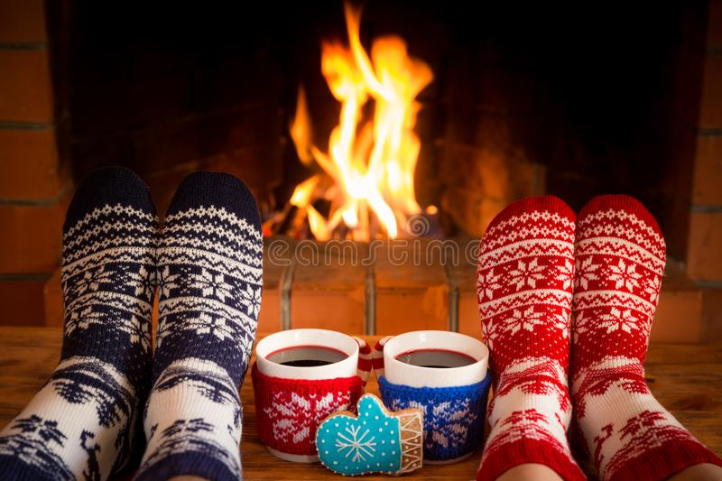 Couple in Christmas socks near fireplace royalty free stock photo