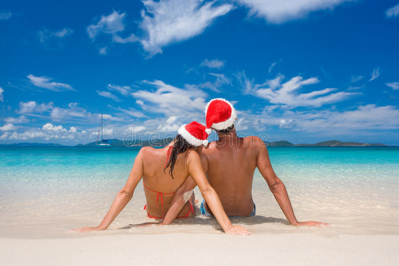 Couple christmas tropical beach. Couple with merry christmas hats on romantic tropical beach for summer holiday