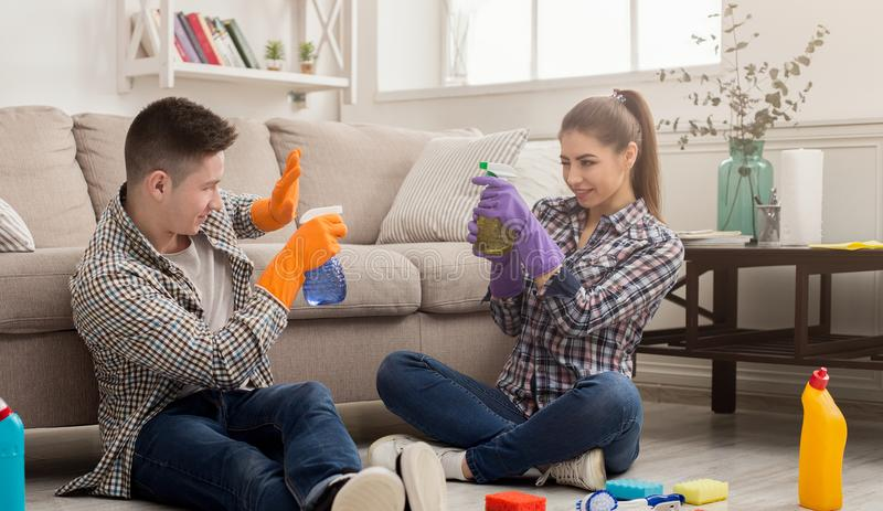 Couple cleaning at home together royalty free stock photos