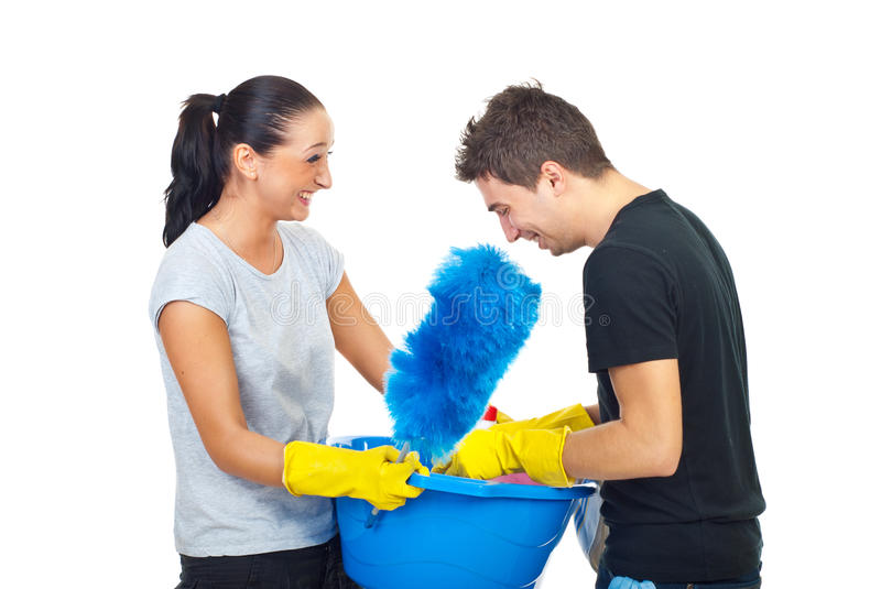 Couple with cleaning products having fun stock image