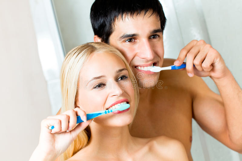 Couple cleaning teeth royalty free stock photo