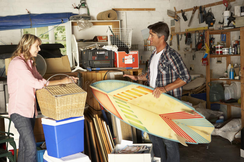 Couple Clearing Garage For Yard Sale royalty free stock photography